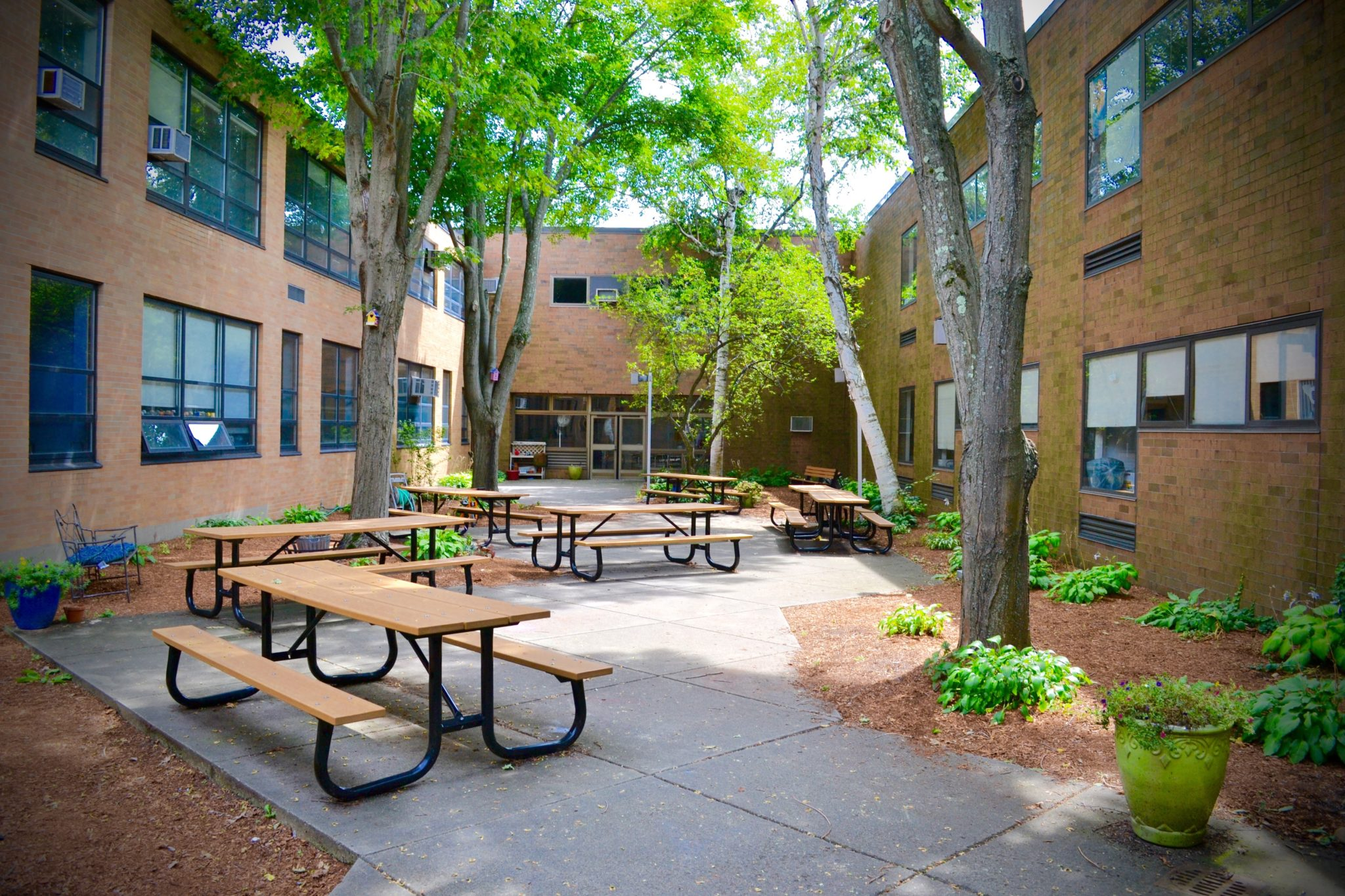 SMS courtyard with tables and landscaping